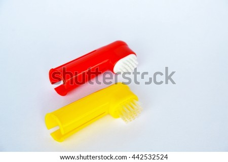 toothbrush used by put in finger for dog and cat on white background