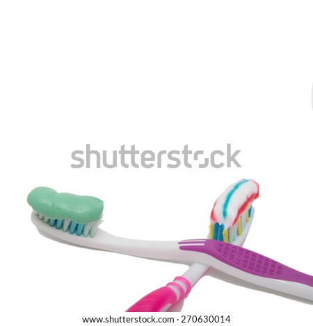 toothbrush with toothpaste on a white background - stock photo