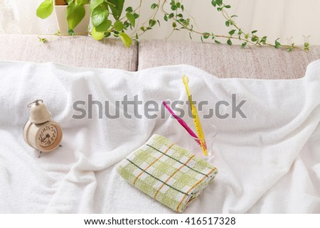 Toothbrush with towel - stock photo