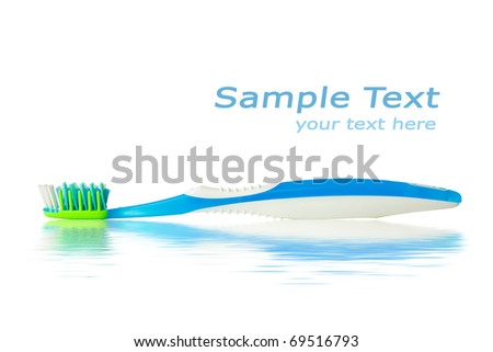 toothbrush with water reflection and copy-space - stock photo