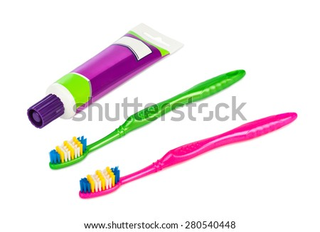 Toothbrushes and paste tube isolated on white background - stock photo