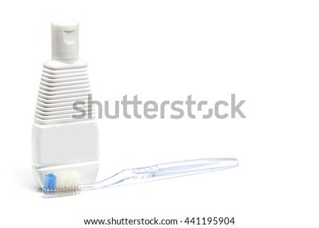 Toothbrushes and shampoo bottles White background - stock photo