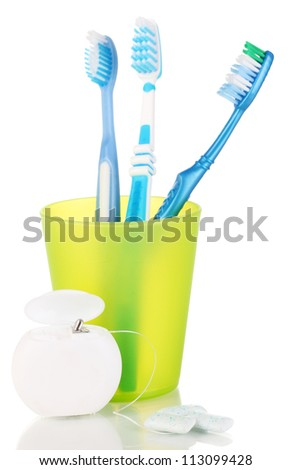 Toothbrushes, chewing gum and dental floss isolated on white - stock photo