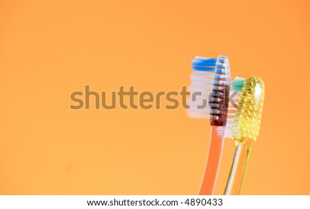 Toothbrushes facing the same direction. - stock photo
