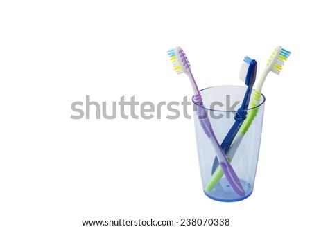 toothbrushes in a glass isolated - stock photo
