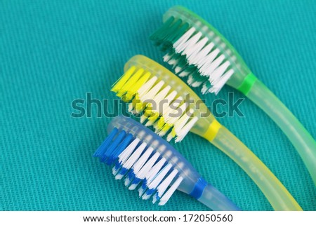 Toothbrushes on cloth copy space  - stock photo