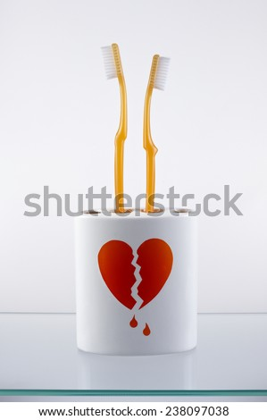 Toothbrushes simulating a newlywed couple had been divorced - stock photo