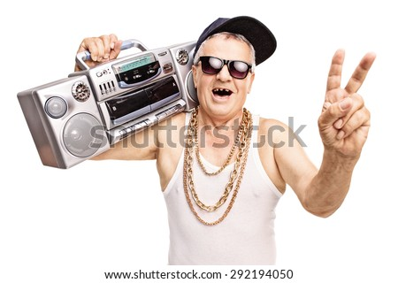 Toothless senior rapper holding a boombox on his shoulder and gesturing with his hand isolated on white background