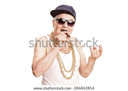 Toothless senior rapper smoking a cigar and making a hardcore sign with his hand isolated on white background - stock photo