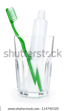 Toothpaste and toothbrush in the glass - stock photo