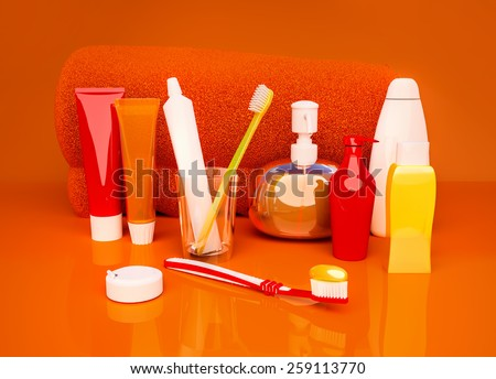 Toothpaste, brush, soap, balm, tooth thread, towel on an orange background. - stock photo