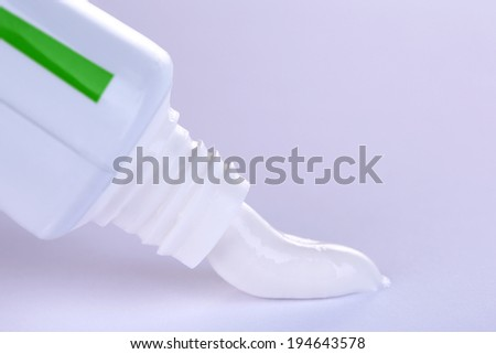 Toothpaste squeezed from tube, close-up, on white background - stock photo