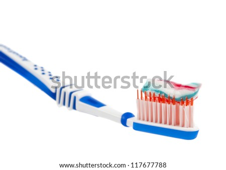 toothpaste with toothbrush isolated on white background - stock photo