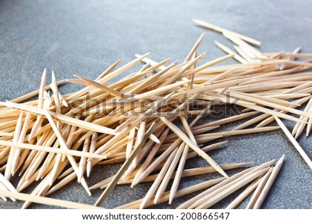 toothpicks on wood background