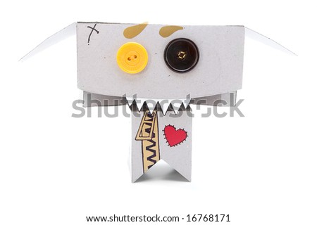 Toothy cardboard figurine with expressive face - stock photo