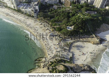Top aerial view of Arpoador Peninsula Beach in Rio De Janeiro, Brazil - stock photo