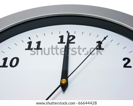 Top area of a wall clock showing 12 am pm - stock photo