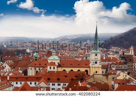Top cityscape view of Prague with historical gothic architecture, on cludy blue sky bakcground. - stock photo