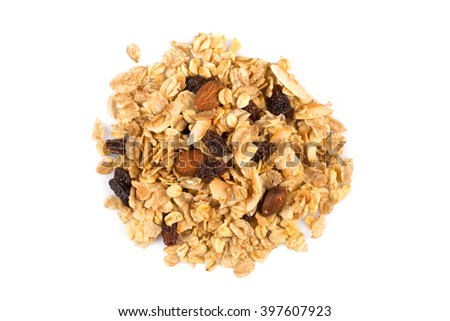 Top close view of a dry mix of fruit and almon nuts cereal on white