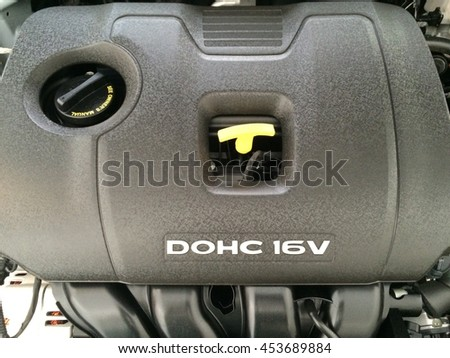 Top cover of car engine with dipstick and oil change access shaft - stock photo