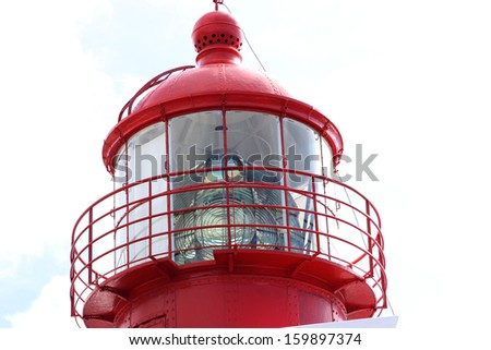 top detail of a red lighthouse - stock photo