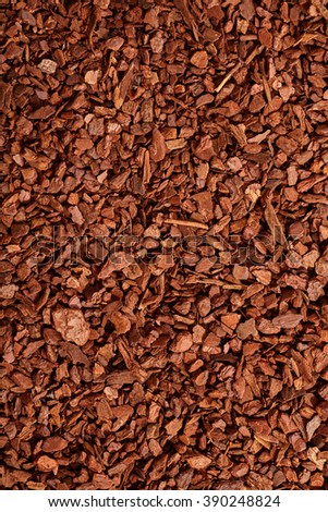 Top down close up view on full frame background of brown natural tree bark mulch with copy space for gardening or nature concepts - stock photo
