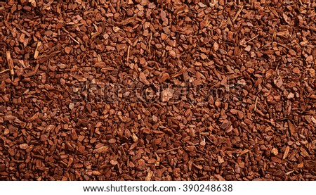 Top down full frame background of brown natural tree bark mulch with copy space for gardening or nature concepts