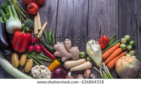 Top down view of a geometrical pattern of fresh, healthy, organic vegetables