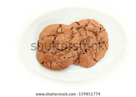 Top Down View Of Chocolate Chewy Cookies On Plate On White Background - stock photo