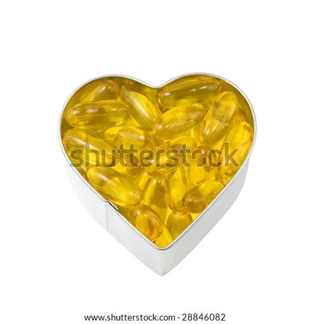 top down view of silver heart filled with salmon oil - stock photo