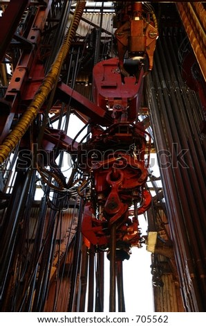 Top drive on an offshore oil rig - stock photo