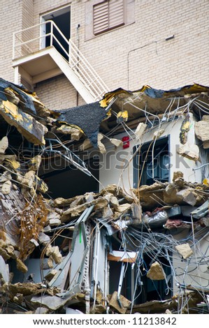 top levels of building demolition - before and after - steps leading down to destruction - part of series - stock photo