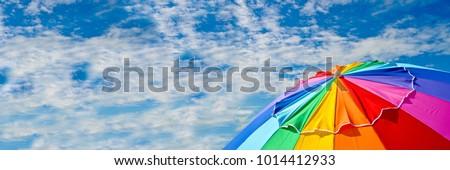 stock-photo-top-of-a-beach-umbrella-agai