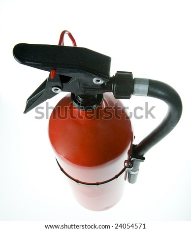 top of a red fire extinguisher showing the handle, and release pin. - stock photo