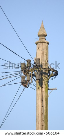 Top of a telegraph pole in landscape aspect. - stock photo