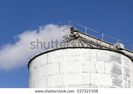 Top of a White Grain Silo against a Blue Sky