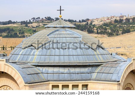 Top of dome with cross of St. Peter in Gallicantu Monastery on Zion's Mount in Jerusalem - stock photo