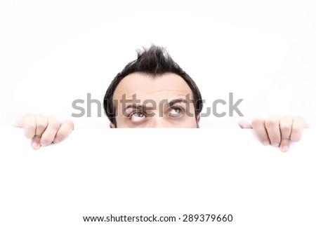 Top of male face looking up behind white banner, isolated on white