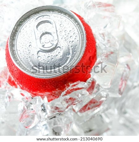 top of metal aluminum beverage drink can with water drop in the a lot of ice - stock photo
