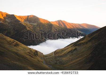 top of mountains in sunset light