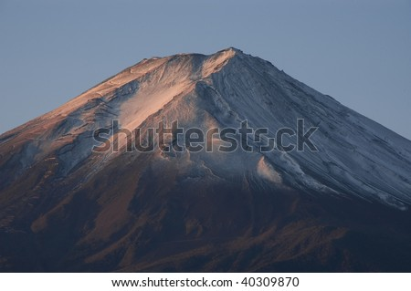 Top of Mt Fuji with snow at dawn. Japan. - stock photo