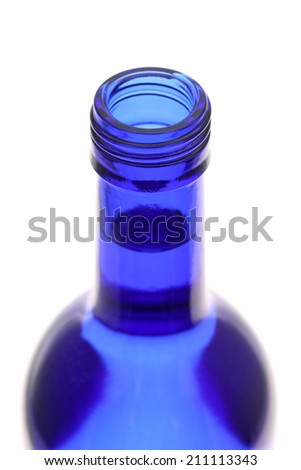 Top of opened blue bottle isolated on white background