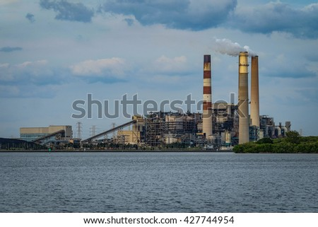top of smoke stacks with smoke coming out of big bend power station operated by teco energy