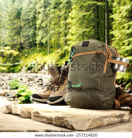 top of stone backpack shoes and forest  - stock photo