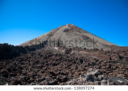 Top of Teide volcano and  lava landscape on Tenerife, Canary Islands, Spain. - stock photo