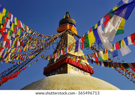 Top of the Boudhanath Stupa with prayer flags. Kathmandu valley, Nepal