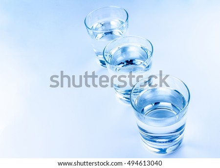 top of view of three drink glasses with water, nutrition and health-care concept, nutrition and health-care concept on white background