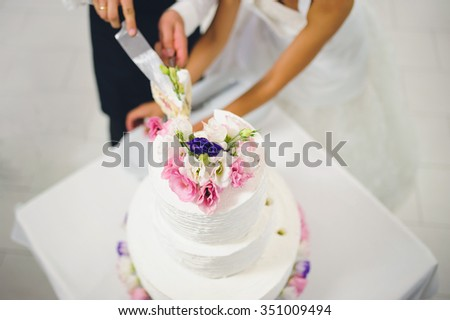 top of wedding cake decorated with flowers - stock photo