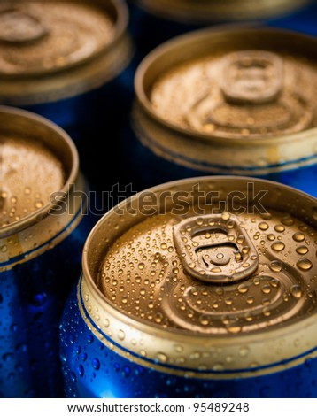 Top part of beer cans, close up view