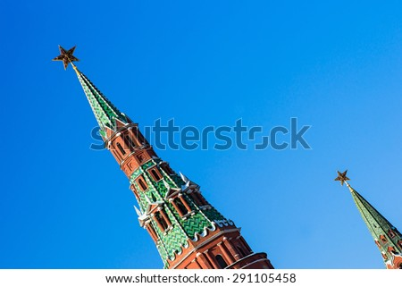 Top parts of Vodovzvodnaya and Borovitskaya towers of Moscow Kremlin against the background of blue sky.  - stock photo